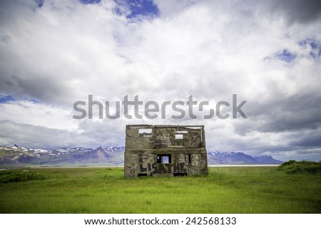 ICELAND - JULY 4, 2014: An abandoned house falling into ruin in rural south Iceland.  Many people have abandoned rural areas for Reykjavik. - stock photo