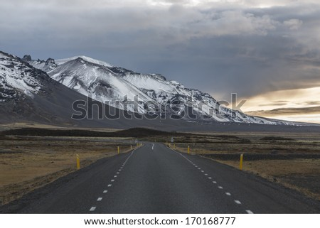 Iceland road leading to volcano  - stock photo