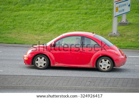 ICELAND - SEP 13: VW Beetle on the road on Sep. 13, 2015 in Iceland. Volkswagen is a German automobile manufacturer and the biggest German automaker. - stock photo