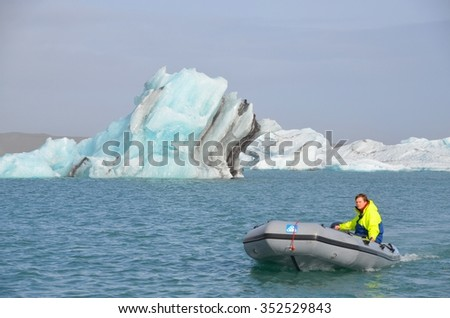 ICELAND - SEPTEMBER 10: Jokulsarlon GLacial Lagoon Boat Tour in Iceland on September 10, 2015. Many people visit the famous glacial lagoon in Iceland every year. - stock photo