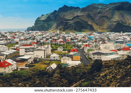 Iceland village city in mountains  - stock photo