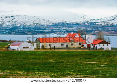 Iceland village city in mountains on field  - stock photo