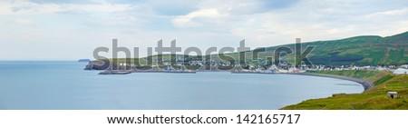 Icelandic coastal village of Husavik in summer. Panorama - stock photo