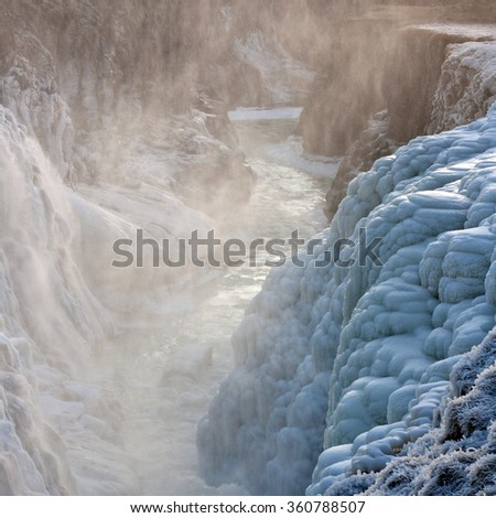 Icelandic Gullfoss waterfall is covered by ice at winter. Close view. - stock photo