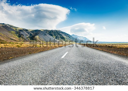 Icelandic road with mountain view. Beautiful summer landscape, southern Iceland. - stock photo