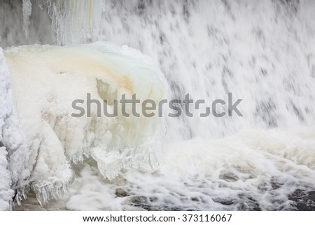 Icicles formation in waterfall - stock photo