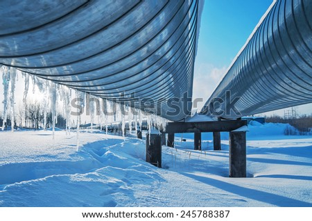 Icicles on a pipe pipeline - stock photo