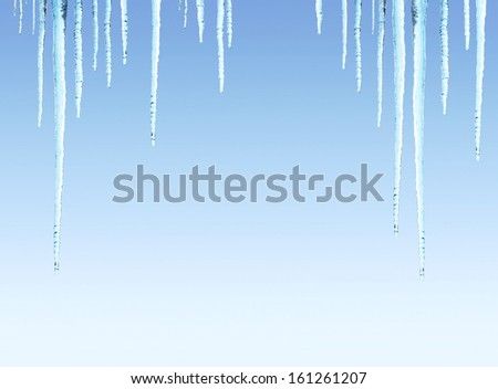 Icicles on blue sky background - stock photo