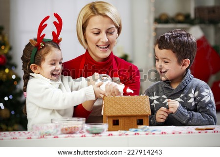 Icing gingerbread house - stock photo