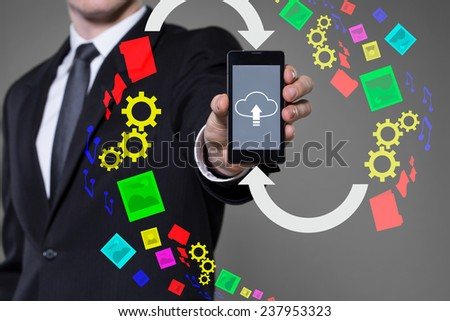 Icon of cloud computing on smartphone's screen - stock photo