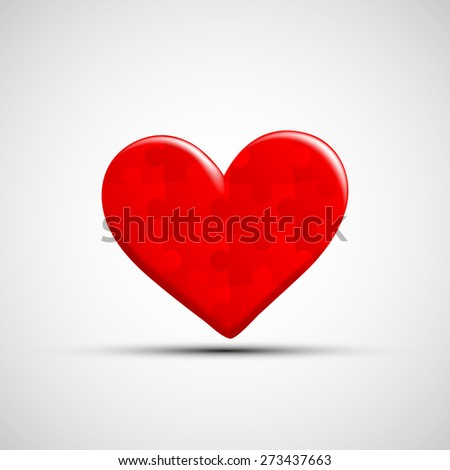 icon of human heart consists of puzzles - stock photo