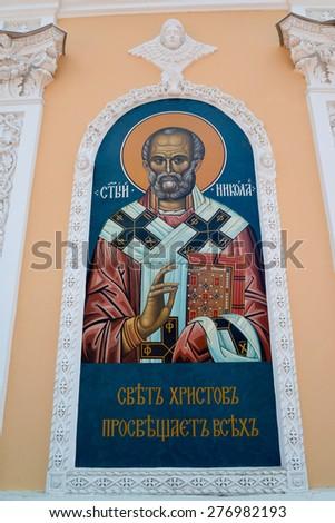 Icon Svyato Nikolay on a chapel wall in Rybinsk, Russia - stock photo