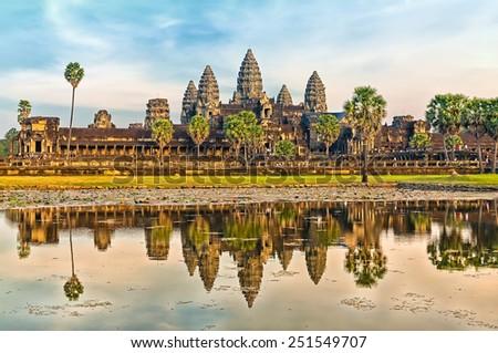 Iconic Angkor Wat reflecting in Lake, Siem reap, Cambodia. - stock photo