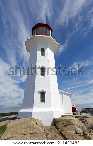 Iconic Lighthouse at Peggy's Cove Nova Scotia Canada - stock photo