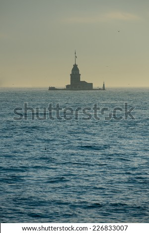 Iconic silhouette of Maiden's Tower in Bosphorus Istanbul - stock photo