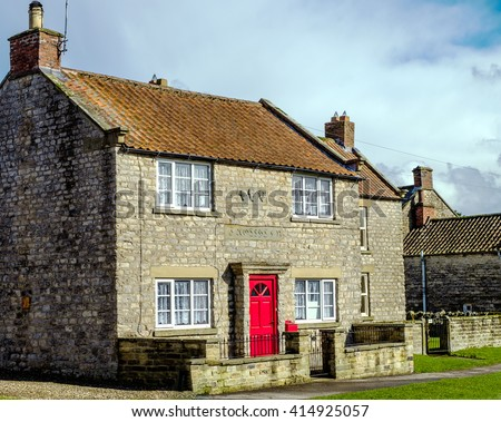 Iconic stone cottage in the village of Appleton le Moors, North York Moors National Park,  North Yorkshire, England - stock photo