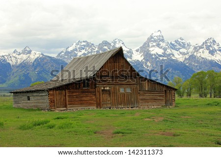 Iconic view of an old wooden barn in Grand Teton National Park, Wyoming, USA. - stock photo