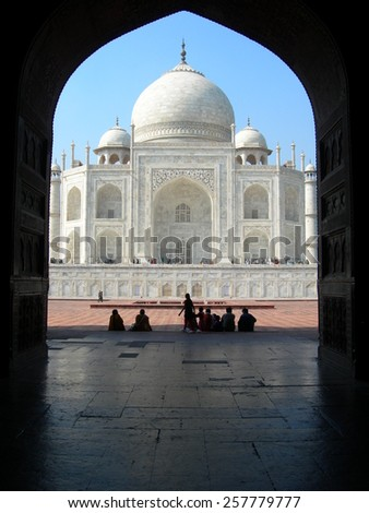 Iconic view of the Taj Mahal mausoleum in Agra, India, from an arched portal of an adjacent mosque - stock photo