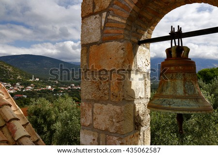 Iconic view on golden bell and typical church on Greek Island Cephalonia, Greece - stock photo