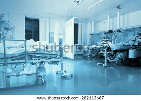 ICU ward with patients in hospital - stock photo