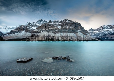 Icy Blue Bow Lake on the Icefield Parkway, Banff National Park, Alberta, Canada - stock photo