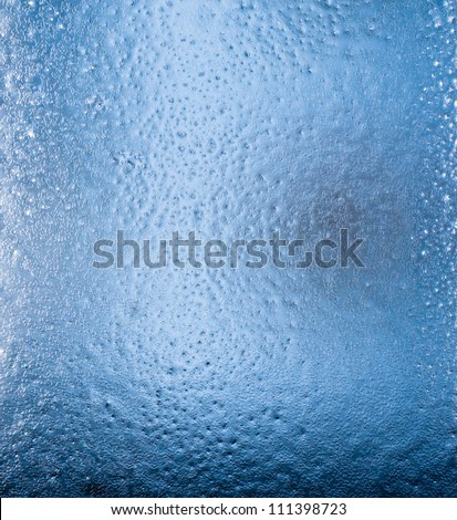 Icy pattern on glass - stock photo