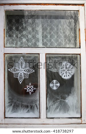 Icy pattern on old wooden frozen window in the village.  - stock photo