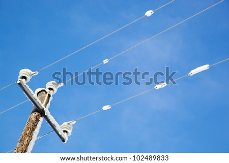 Icy power lines - stock photo