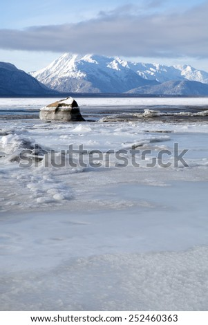 Icy winter beach on the Chilkat River in Alaska. - stock photo