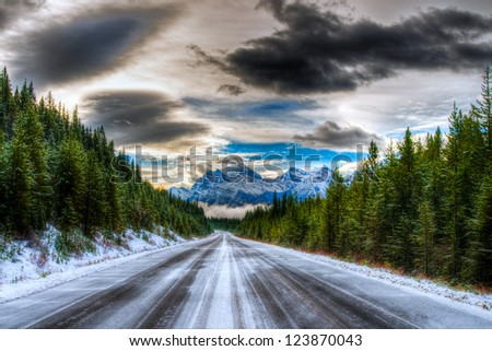 Icy winter road, Icefields Parkway, Banff and Jasper National Parks Alberta Canada - stock photo