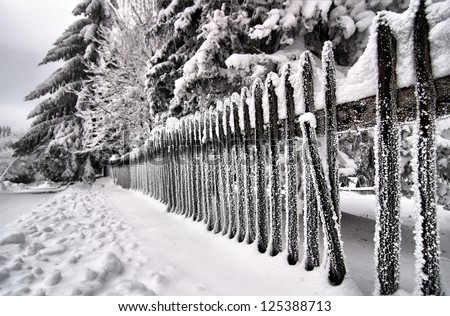 Icy wooden fence - stock photo