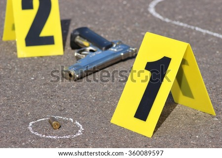 id tents at crime scene after gunfight - stock photo