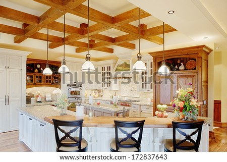 Idaho Falls, Idaho, USA  Aug. 12, 2008 The interior of a residential kitchen showing modern Cabinetry, pendant lighting and comfortable surroundings. - stock photo