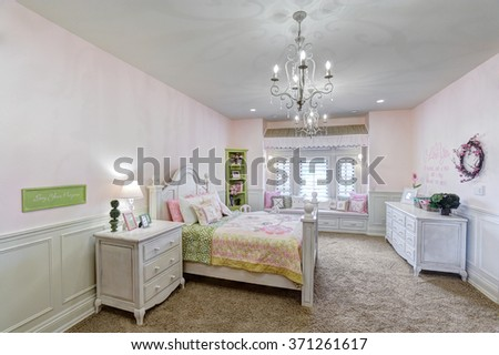 Idaho Falls, Idaho, USA Sep, 18, 2008 A luxurious girls bedroom with a queen sized bed, in a custom upscale home. - stock photo