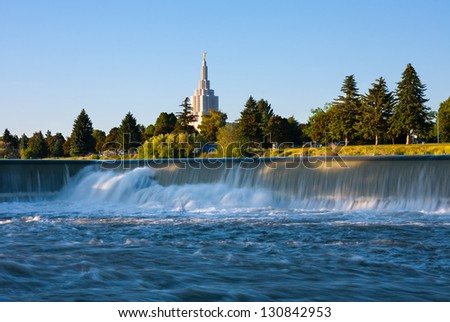 Idaho Falls Temple next to Snake River in Idaho Falls - stock photo