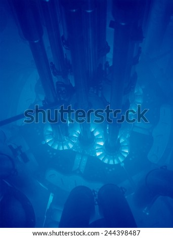Idaho National Laboratory's Advanced Test Reactor core powered up, with the fuel plates glowing bright blue. The core is submerged in water for cooling. - stock photo