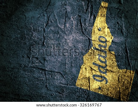 idaho outline map on grunge background - stock photo