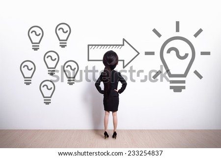 idea and innovation concept - Back view of business woman look light bulb - big head cute woman - stock photo