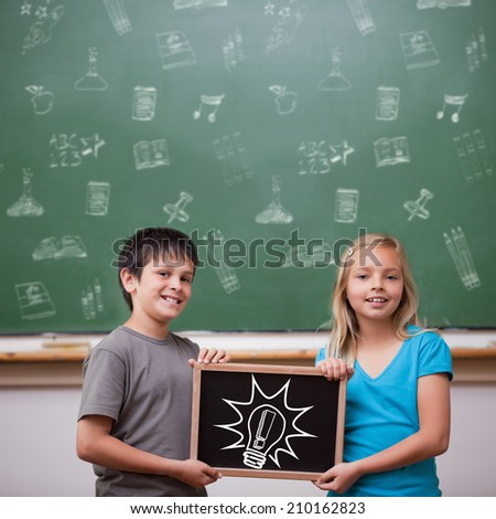 Idea and innovation graphic against cute pupils showing chalkboard - stock photo