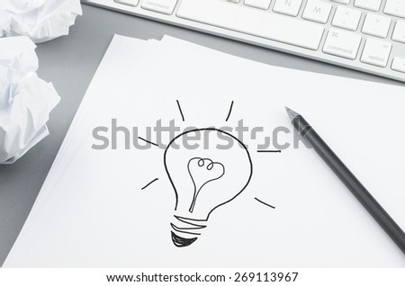 Idea buble on white paper with pencil - stock photo