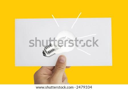 Idea bulb in hand - stock photo