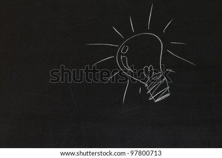 idea bulb on blackboard background - stock photo
