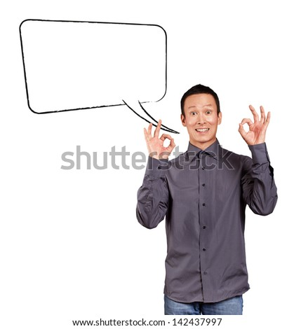 Idea concept. Asian man shows OK with both hands, with speech bubble - stock photo