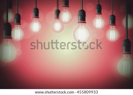 Idea concept background with light bulb in pink gradient background - stock photo