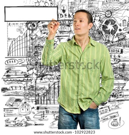 Idea concept, man writing something on glass board with marker - stock photo