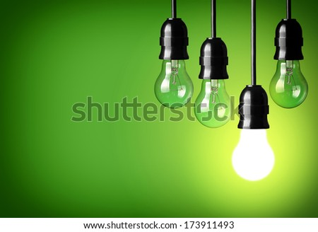 Idea concept on green background - stock photo