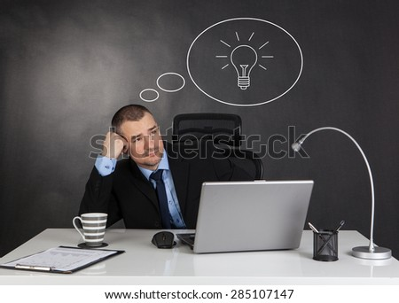 Idea concept. Thinking businessman in office.  - stock photo