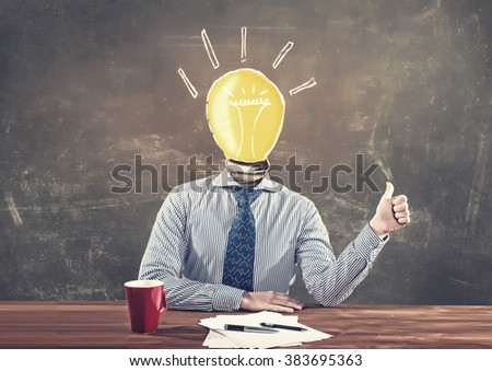 Idea concept with businessman and light bulb instead of his head - stock photo