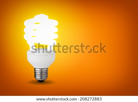 Idea concept with glowing energy saver bulb - stock photo