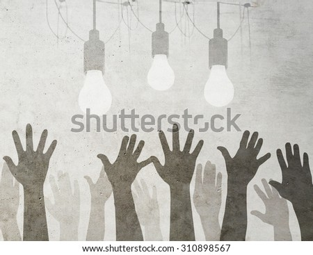 Idea concept with light bulbs and raised hands on grunge background. - stock photo